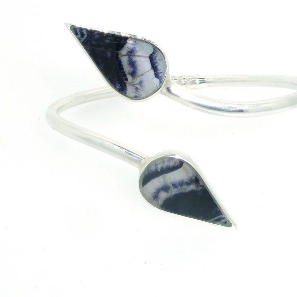 Modern Twist Bangle in silver with blue john